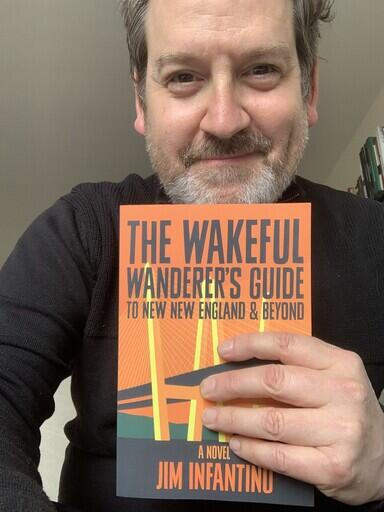 Adam Schartoff with Wakeful Wanderer book