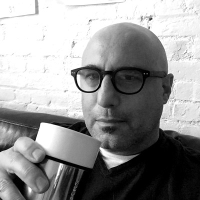 Picture of Jim Infantino drinking coffee