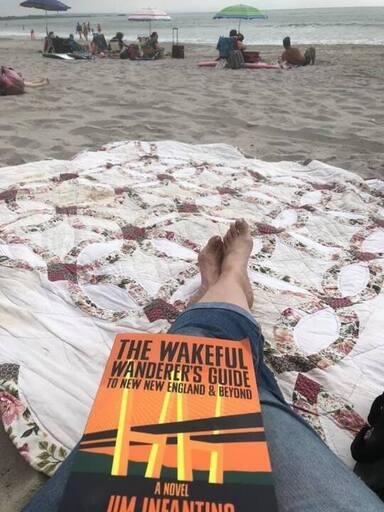 Wakeful Wanderer paperback at the beach